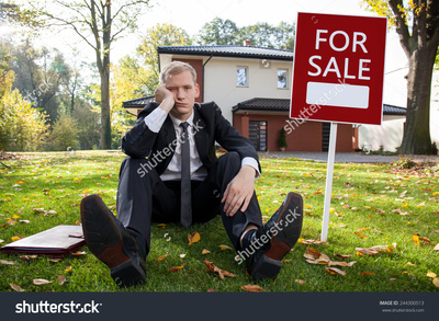 Stock photo worried real estate agent and house for sale 244300513