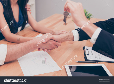 Stock photo close up photo of handshake broker giving keys of new house 444616459