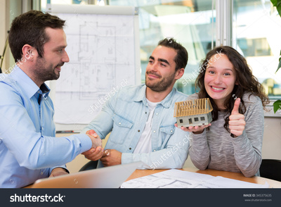 Stock photo view of a young attractive people meeting real estate agent at the office 345375635
