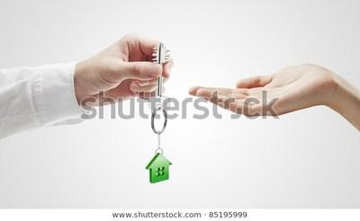 Man handing house key woman 600w 85195999